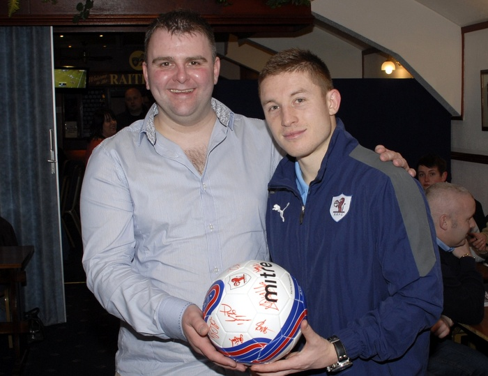 Norman McLeod receives a signed ball from Baird