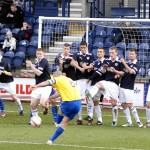 Morton's Michael Tidser's free kick is blocked by the Raith wall