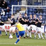 Morton's Michael Tidser's free kick is blocked by the Raith wall