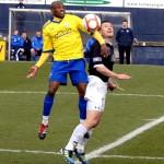 Fouad Bachirou outjumps Raith captain Grant Murray.jpg
