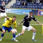 Morton's Archie Campbell and Raiths Iain Davidson keep their eye on the ball