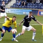 Morton's Archie Campbell and Raiths Iain Davidson keep their eye on the ball
