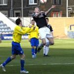 Morton's Archie Campbell and Raith's Iain Davidson keep their eye on the ball