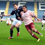Damian Casalinuovo and Craig Mckeown battle for ball