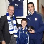 Bill McMillan and 11 year old Jack MacDonald present Brian Graham with his Man of the Match award