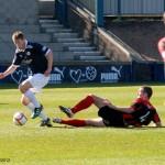 Sub Iain Williamson evades a tackle