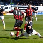 Hamill beats Carmichael to the ball