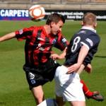 Allan beats Alan to win the ball