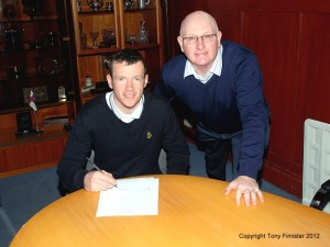 Eddie Malone signs the Pre Contract