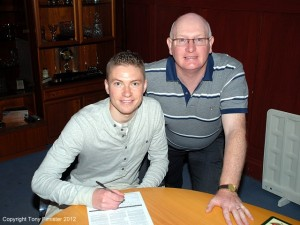 Pat Clarke signs