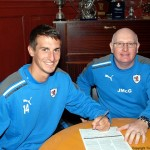 Grant signs on with John McGlynn, June 2012