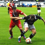 Allan Walker sheilds the ball from Richard Brittain
