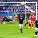 Dave McGurn gets down to save a County effort