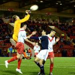 Grant Adam clears from Brian Graham