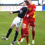 Pat Clarke and Callum Morris clash in the air