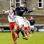 Brian Graham beats Riki Lamie to the ball