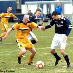 Lithgow and Graham battle for the ball