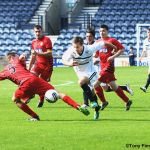 Lewis Vaughan heads for goal