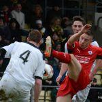 Baird gets his leg over the ball.
