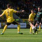Conroy slips the ball to Scott.