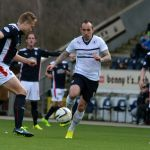 Mark Stewart gets his foot on the ball.