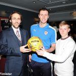 Lewis with ball sponsors Roberto Morris and Ben McCafferty