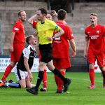 87mins Montrose players can't believe as referee Colin Steven points to the penalty spot