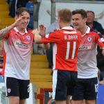 Bobby Barr and Ross Matthews congratulate Declan McManus.