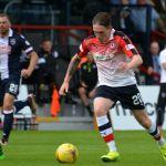 McManus runs past McEveley.