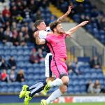 ROSS CALLACHAN beats Mark Durnan to the ball -  
