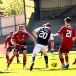 Declan McManus surrounded by Ayr players