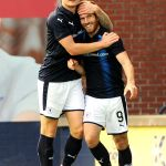 Liam Buchanan  celebrates after scoring with Euan Murray
