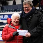 Val McDermid and James Runcie with the 50/50 prize winnings. The winner collected their prize money from the office at full time and won £550.