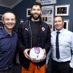MOTM Aaron Lennox presenting the Ball Sponsors with their signed ball