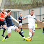 Raith v Montrose -  Flanagan beats Masson to the ball -  credit- Fife Photo Agency
