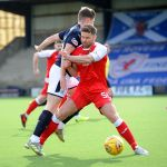 Raith v Dumbarton  - Craig Barr blocks Kevin Nisbet - credit- Fife Photo Agency