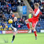 Raith v Dumbarton  - Grant Gillespie clears - credit- Fife Photo Agency