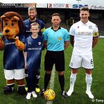 3 mascot Lewis with the Ref and captains