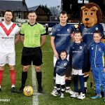 2 Mascots with the Ref and captains