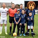 3 The mascots with the ref and captains