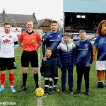 4 THE MASCOTS WITH THE REF AND CAPTAINS