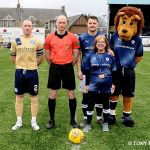 11 MASCOT MARGIE LINES UP WITH THGE REF. AND CAPTAINS