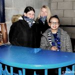 8 Woman's day fans admire the refurbished turnstile on display
