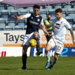 24th April 2021; Dens Park, Dundee, Scotland; Scottish Championship Football, Dundee FC versus Raith Rovers; Shaun Byrne of Dundee challenges for the ball with Brad Spencer of Raith Rovers